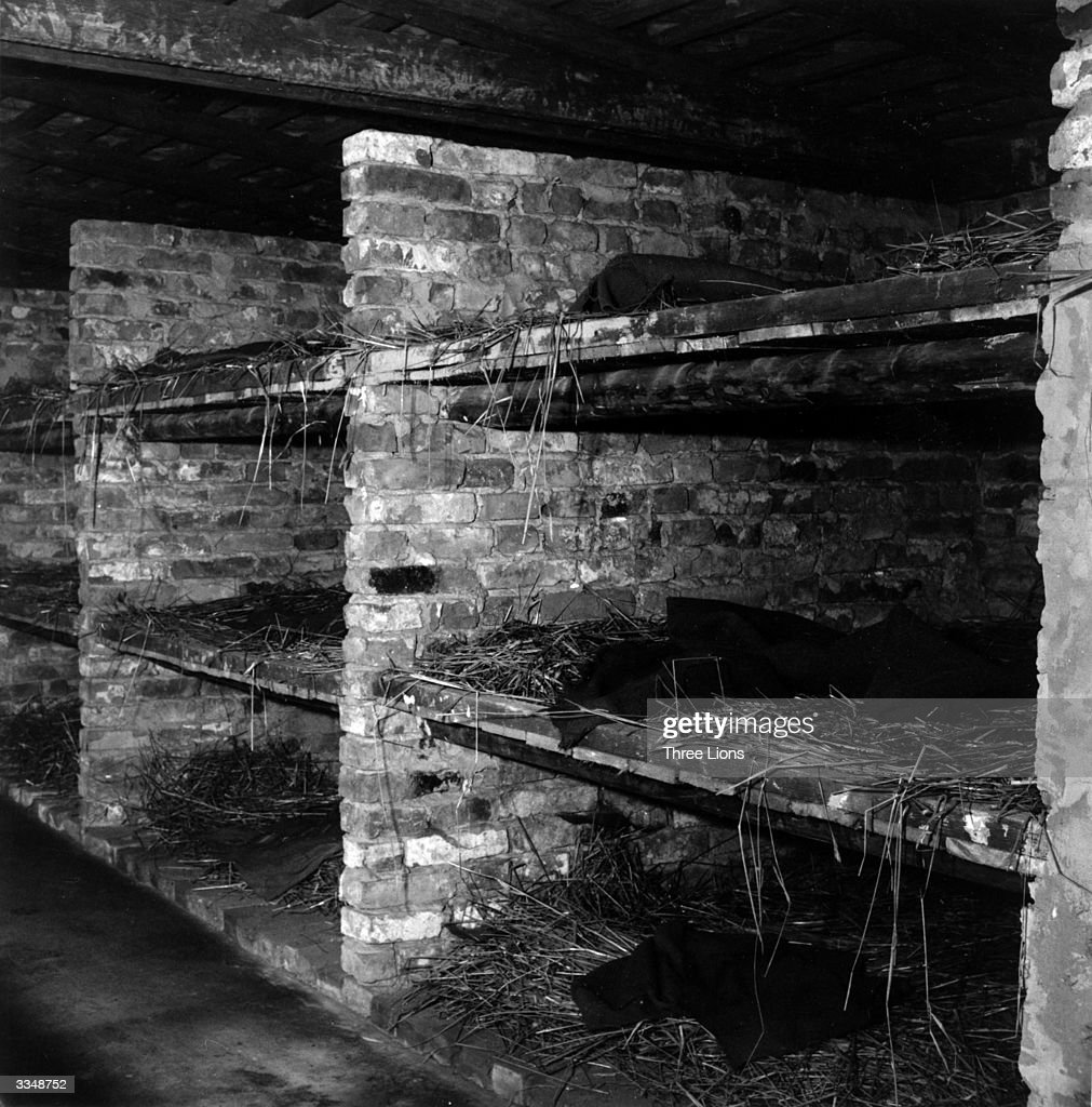 Beds, on which four or five people had to sleep, in Auschwitz concentration camp.