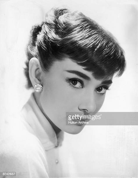 Belgianborn actor Audrey Hepburn wearing earrings