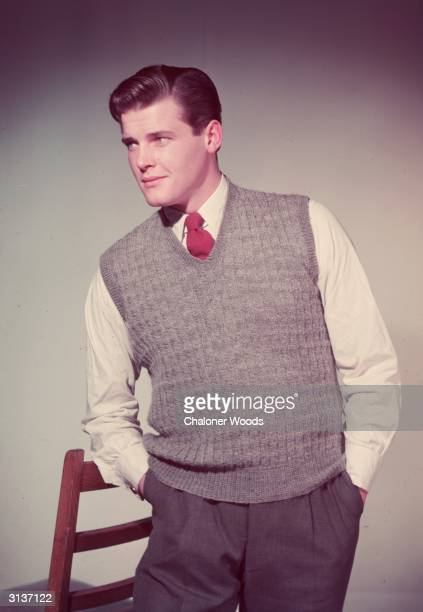 British film star Roger Moore wearing a grey tank top in his modelling days before he found fame as The Saint and James Bond