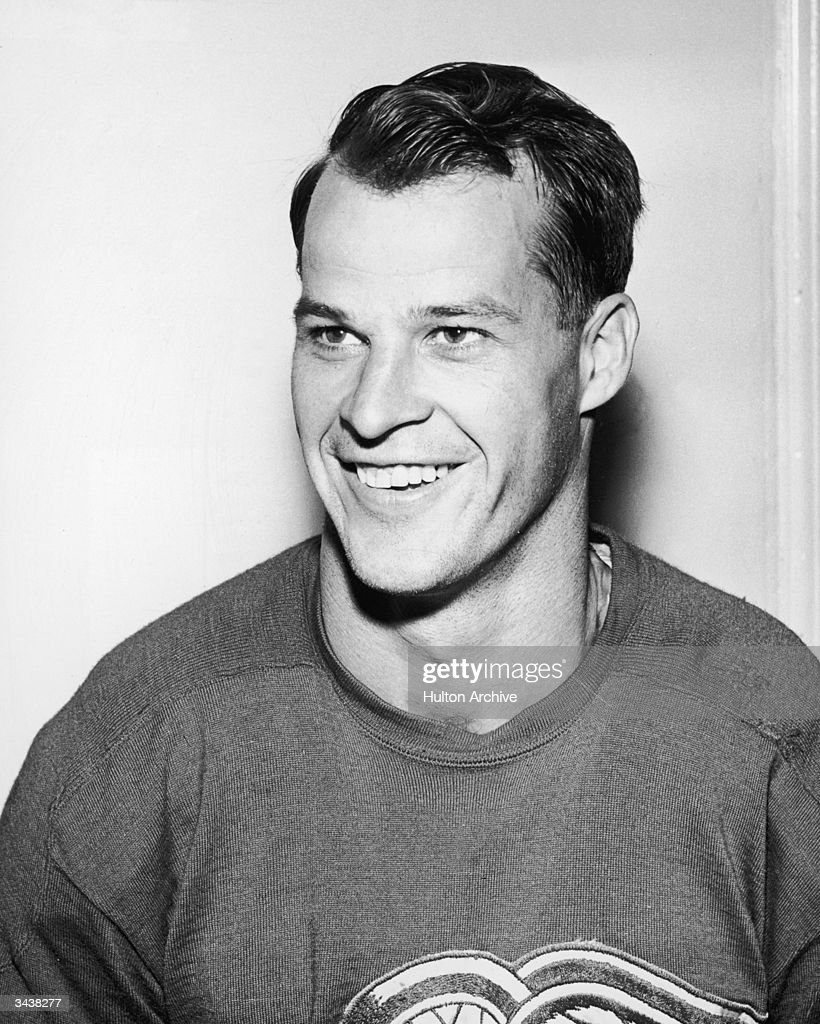 canadian hockey player gordie howe smiling in a hockey jersey