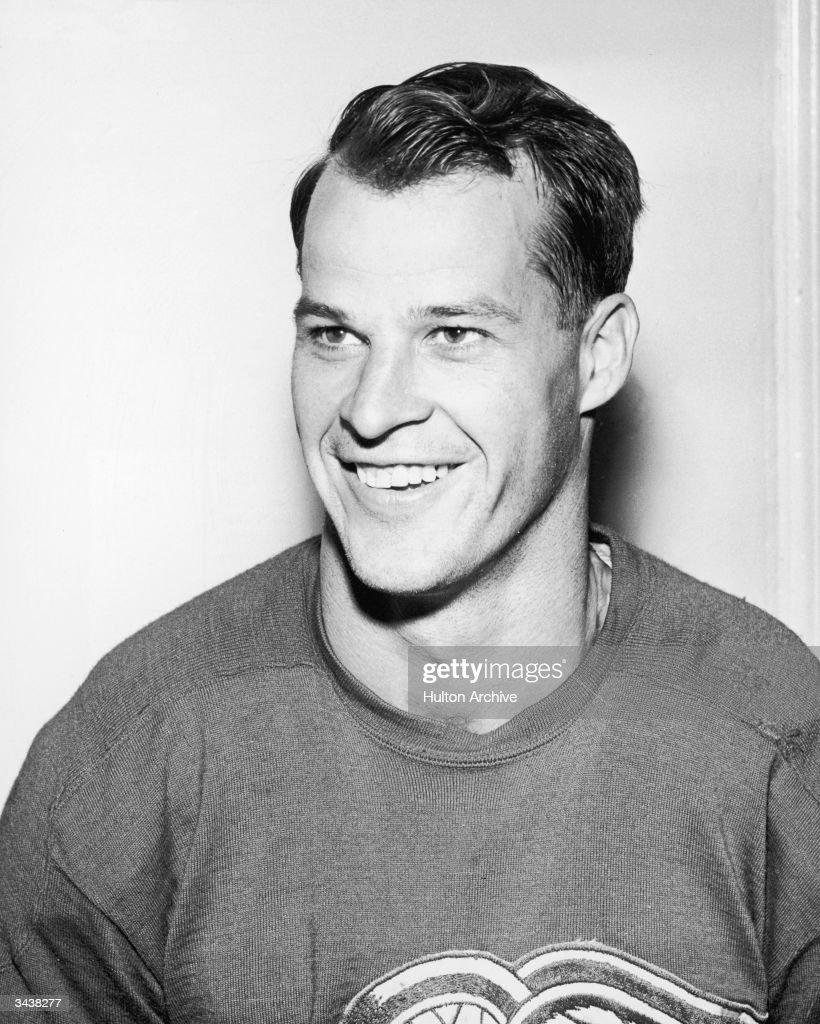 canadian hockey player gordie howe smiling in a hockey jersey