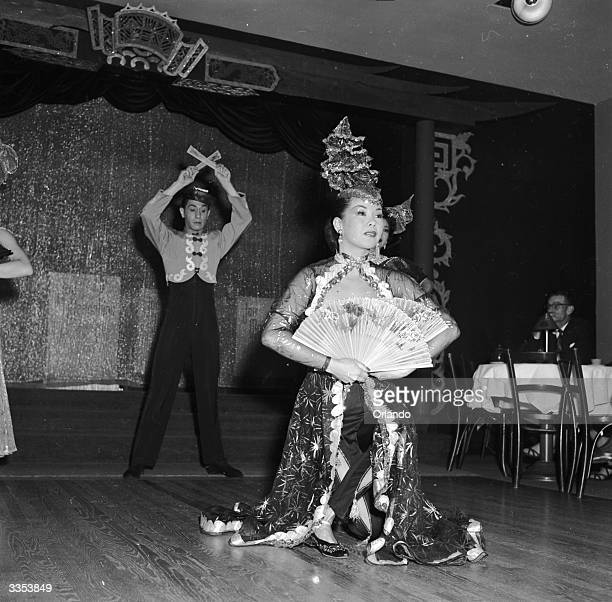Chinese dancers Mae Tai Sing and Tony Wing perform an elaborate floor show at Forbidden City a nightclub in Chinatown San Francisco