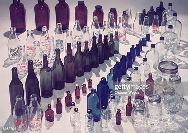 Clear glass milk bottles coloured medicine bottles and airtight kilner jars