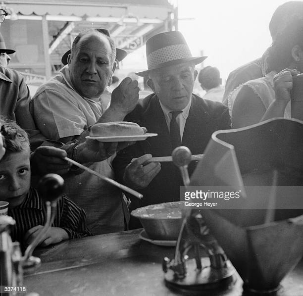 Customers crowding to get served at Nathan's famous hotdog stand in Coney Island New York