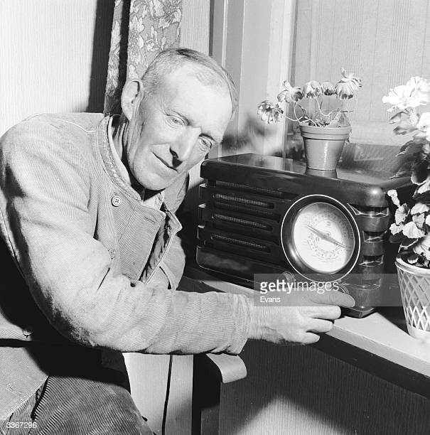 Dutch dyke watchman Jan listens to the late weather forecast on his radio before turning in for the nighht