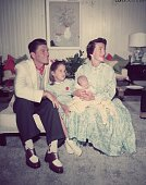 Family portrait of American actor Ronald Reagan wearing a polkadot scarf and two tone shoes with his wife American actor Nancy Davis their daughter...