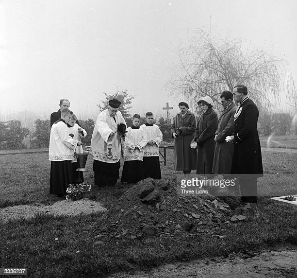 Father Van den Kroon conducting a burial service