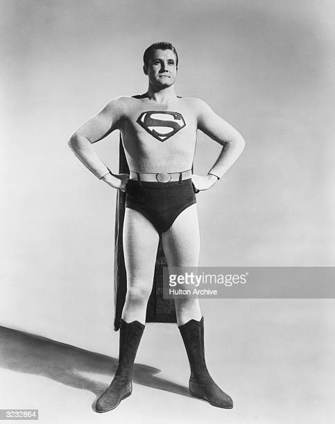 Fulllength studio portrait of American actor George Reeves in costume as the Man of Steel from the TV show 'Superman'