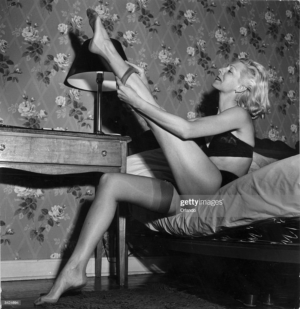 Grisha a hard working dancing girl putting on her nylons