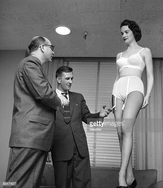 In the Manhattan showroom of a underwear manufacturer a buyer looks at a new Sarong brand bra and pantie combination garment modelled for him