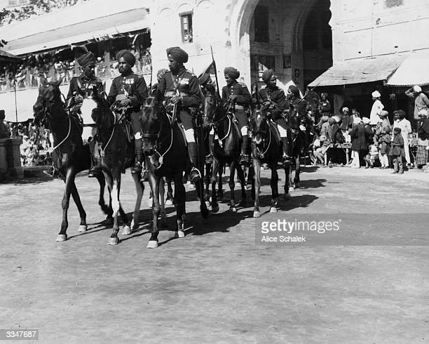 Indian cavalry riding three abreast during the wedding procession of an aristocratic Sikh