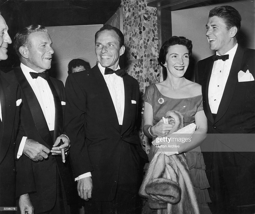Actors <a gi-track='captionPersonalityLinkClicked' href=/galleries/search?phrase=Jack+Benny&family=editorial&specificpeople=93561 ng-click='$event.stopPropagation()'>Jack Benny</a>, <a gi-track='captionPersonalityLinkClicked' href=/galleries/search?phrase=George+Burns+-+Actor&family=editorial&specificpeople=90939 ng-click='$event.stopPropagation()'>George Burns</a> (1896 - 1996), <a gi-track='captionPersonalityLinkClicked' href=/galleries/search?phrase=Frank+Sinatra&family=editorial&specificpeople=70024 ng-click='$event.stopPropagation()'>Frank Sinatra</a>, Nancy Davis Reagan, and her husband <a gi-track='captionPersonalityLinkClicked' href=/galleries/search?phrase=Ronald+Reagan+-+US+President&family=editorial&specificpeople=69998 ng-click='$event.stopPropagation()'>Ronald Reagan</a> dressed in formal attire and smiling in the lobby of a hotel.