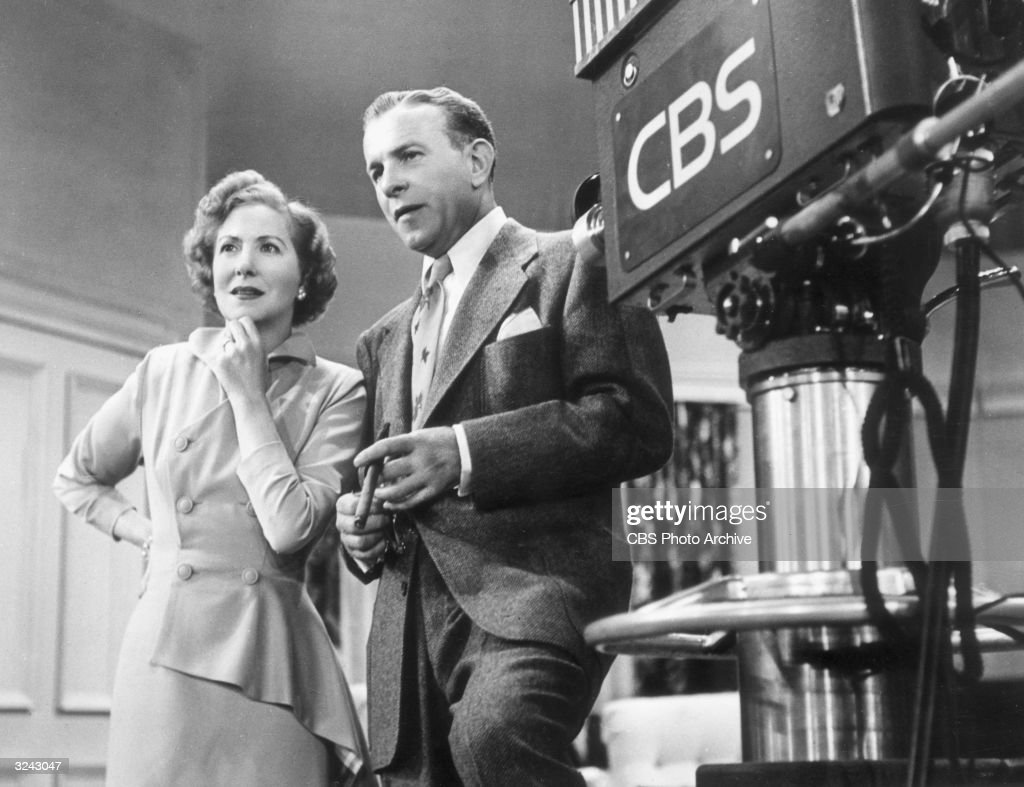 Married American comedy team George Burns and Gracie Allen standing next to a television camera on the set of their TV series 'The George Burns and...