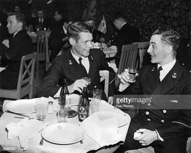 Midshipmen Rhodes Boykin and William R Kent III from the US carrier 'Randolph' lunch at the Saldjobagen restaurant outside Stockholm