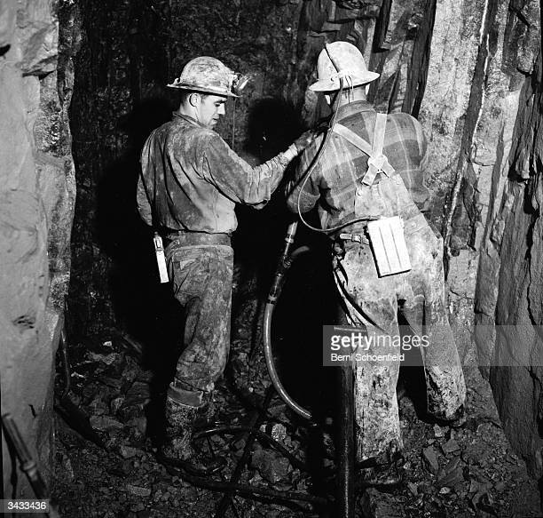 Miners drilling in silver mines in the revitalised town of Cobalt Ontario