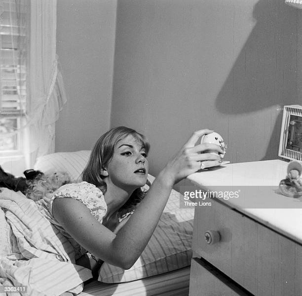 Model Jackie Cahill wakes up early at her alarm call ready for a day's work She is employed by Ford's Model Agency in New York