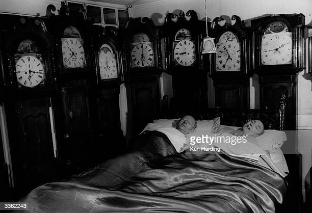 Mr and Mrs Charles Bromley of Belper Derbyshire at home with part of their collection of 109 grandfather clocks