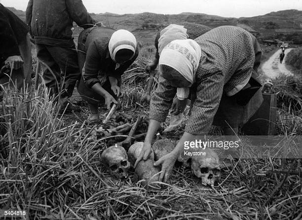 Okinawa women collecting the remains of some 20000 soldiers killed in southern Okinawa during World War II An estimated 190000 Japanese and Okinawans...
