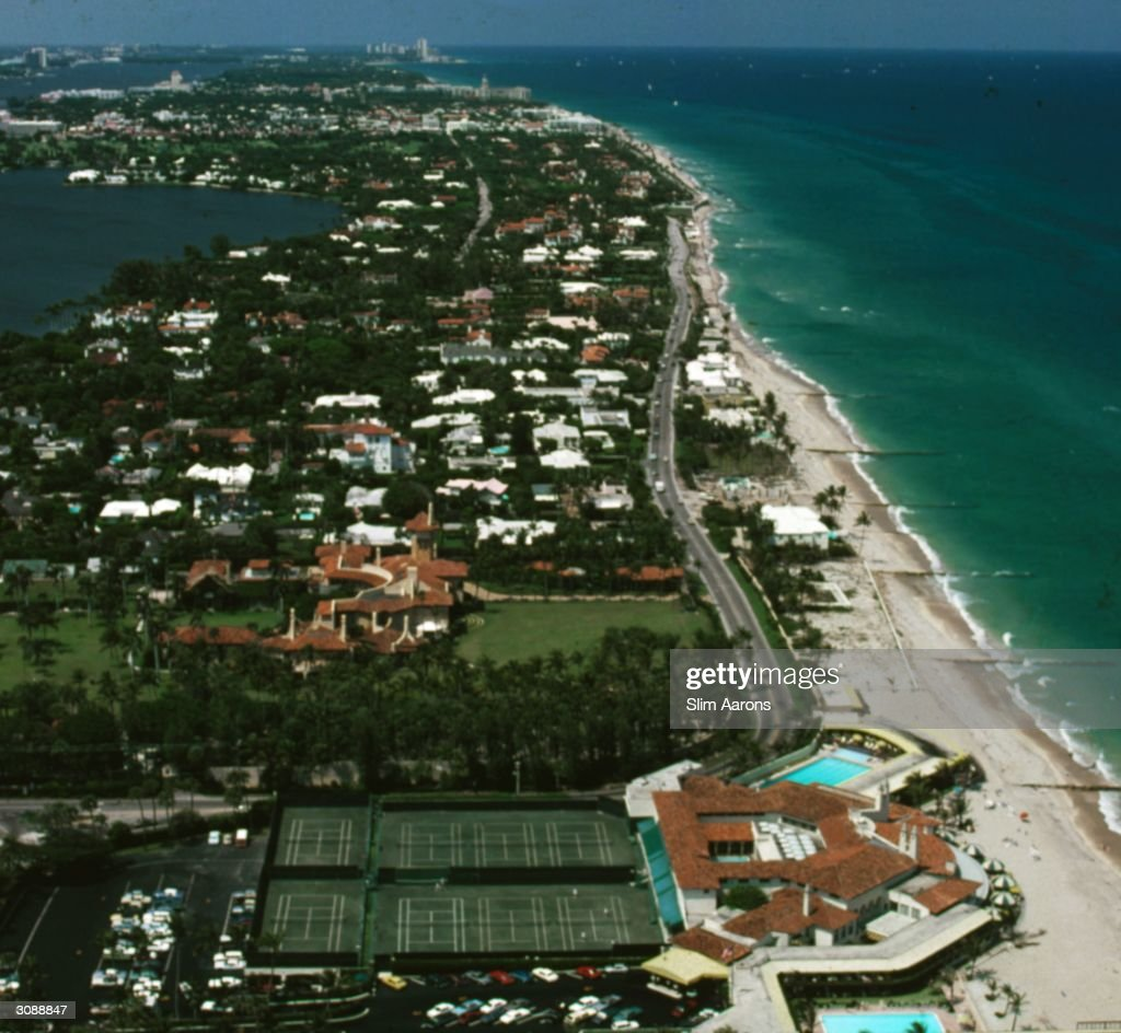 Palm Beach's 'gold coast' as seen from a helicopter. In the foreground is the Bath and Tennis Club built in 1926, beyond on the left is Mar-A-Lago, the house belonging to Marjorie Merriweather Post Close Hutton Davies May. A Wonderful Time - Slim Aarons