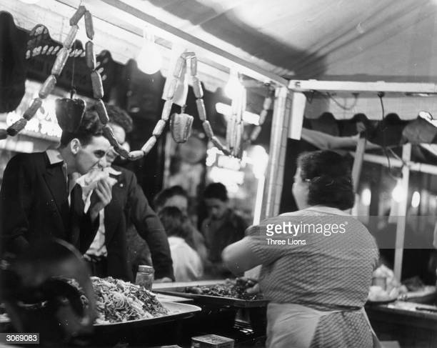 People at an Italian food stall in Harlem New York