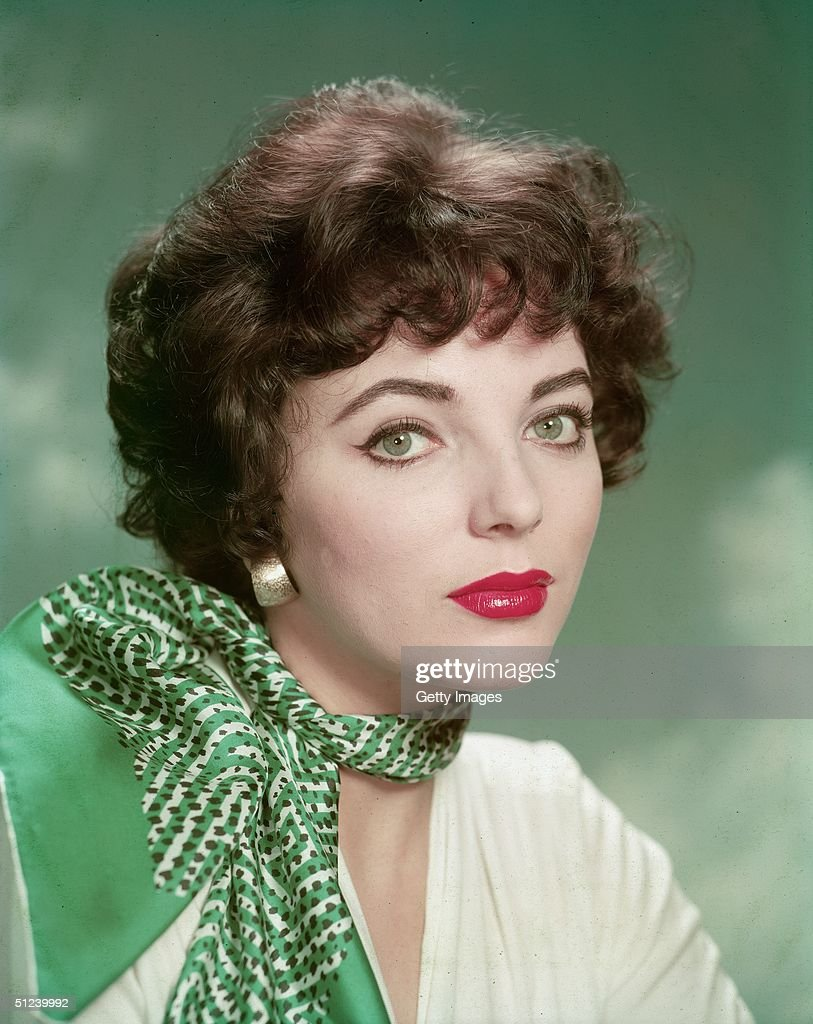 Circa 1955, Promotional portrait of British actor Joan Collins wearing a printed scarf, 1950s.