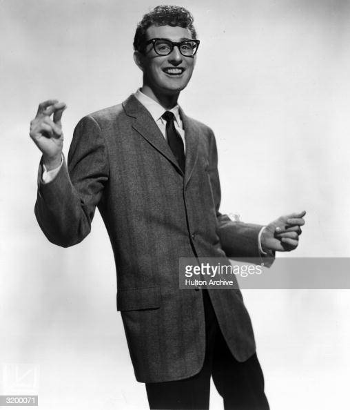 Rocknroll star Buddy Holly snapping his fingers