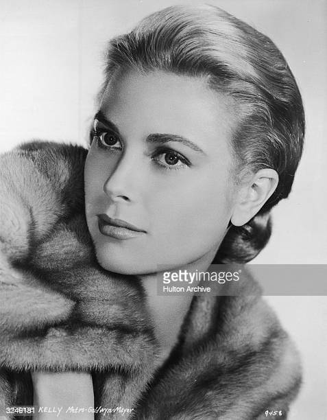 Studio headshot portrait of American actor Grace Kelly wearing a fur coat 1950s