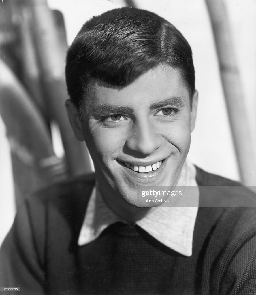 Studio headshot portrait of American comedian and actor <a gi-track='captionPersonalityLinkClicked' href=/galleries/search?phrase=Jerry+Lewis+-+Comedian&family=editorial&specificpeople=202947 ng-click='$event.stopPropagation()'>Jerry Lewis</a> smiling in a sweater and collared shirt.