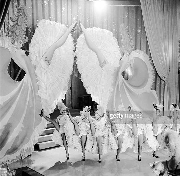 The chorus line at the Folies Bergere performing high kicks while dancing to 'Gaite Parisienne'