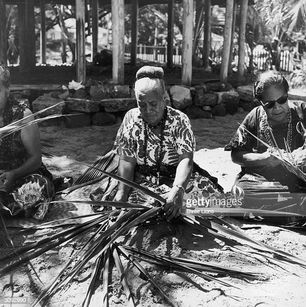 Women weaving rushes in kaiolani park in Waikiki Hawaii