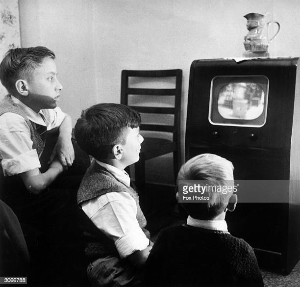 Young boys watching an early television set