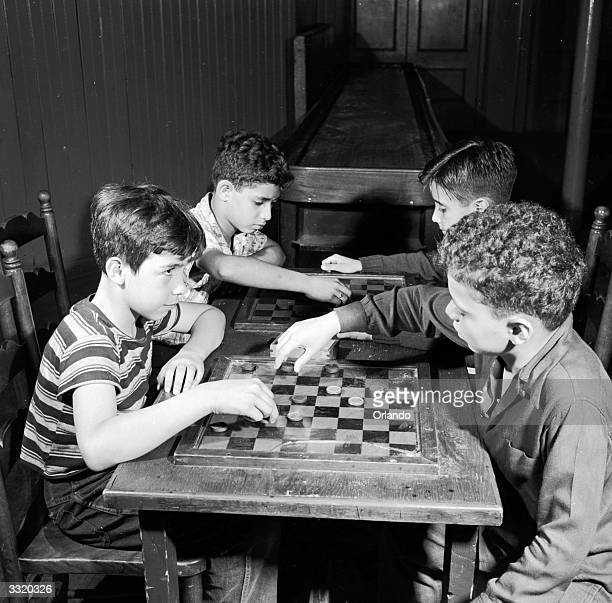Youngsters play checkers at the Uptown branch of the YMCA New York