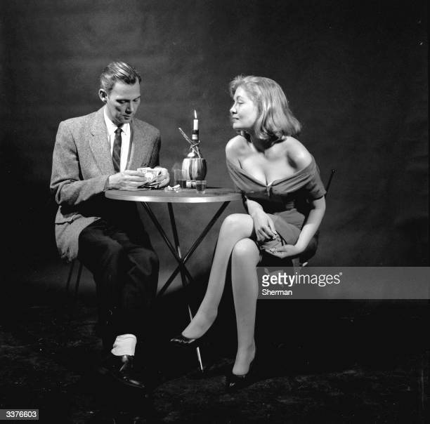 A couple appearing to enjoy a bottle of wine but the woman is swindling the man by switching the ring she has convinced him to buy for an inexpensive...