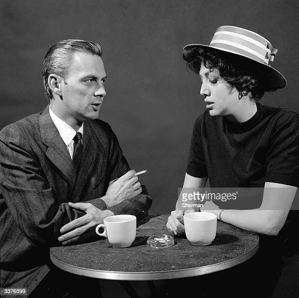 A couple having a discussion over a cup of coffee