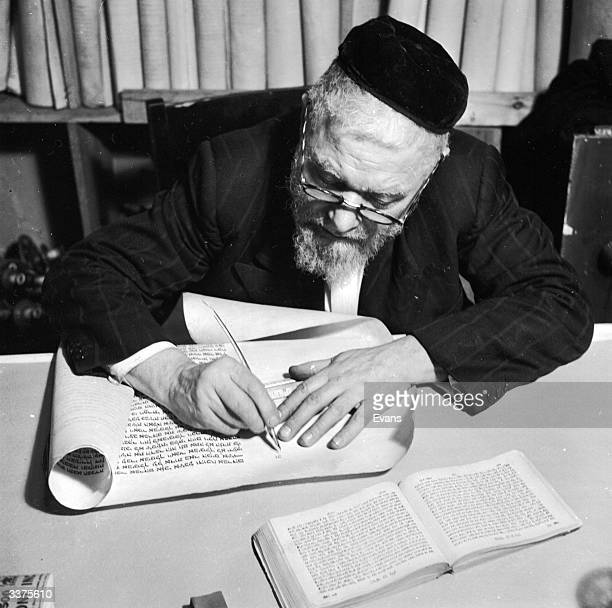 A scribe copying the intricate calligraphy of the Torah
