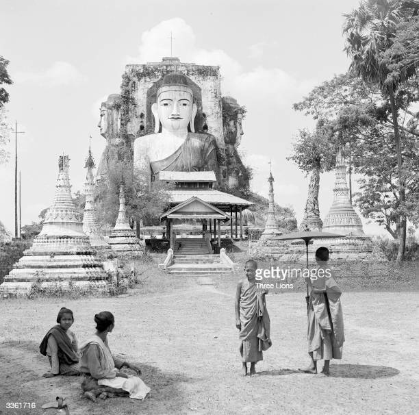 A threefaced shrine of Buddha at a school for Buddhist monks in between Rangoon and Pego Burma