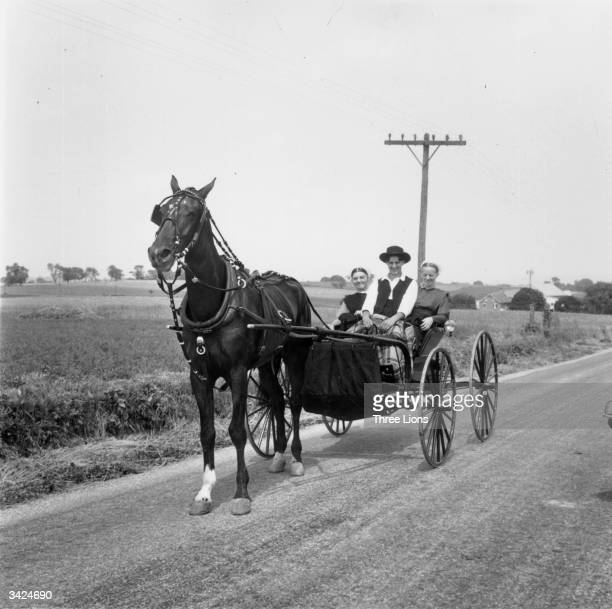 An Amish youth takes his girlfriend for a buggy ride chaperoned by his sister