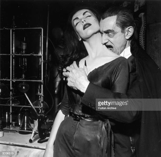 AustrianHungarianborn actor Bela Lugosi playing Dracula prepares to bite into Finnishborn actor and television host Vampira's neck as they clasp...