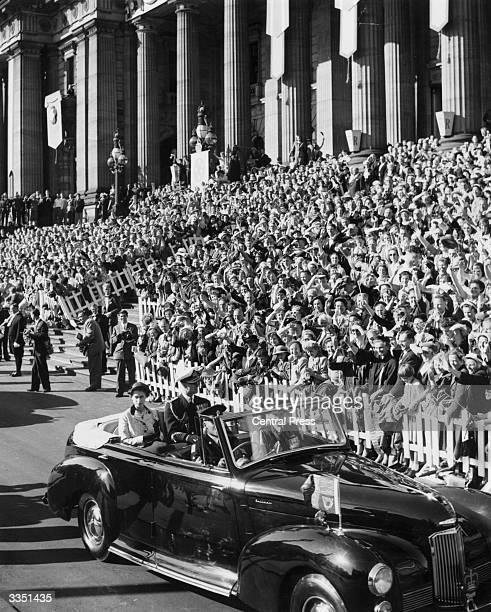 Large crowds welcoming Queen Elizabeth II and the Duke Of Edinburgh to Melbourne