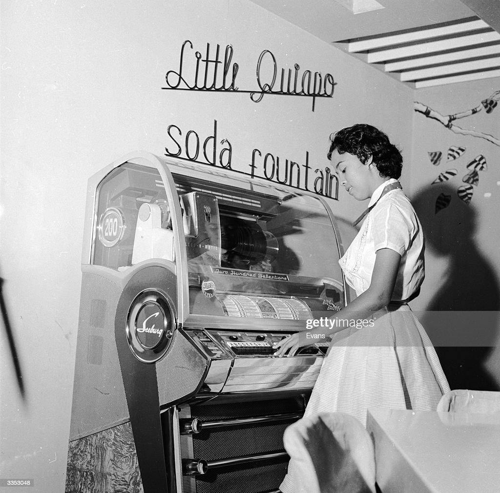 Playing the jukebox at 'The Little Soda Fountain' in Manila.