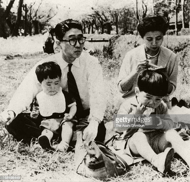Circa 1956 Shintaro Abe soninlaw of Foreign Minister Nobusuke Kishi holding his second son Shinzo onto his lap while dauther of Kishi and wife of...