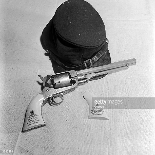 The military cap and Whitney Navy six shot single action 36 calibre percussion revolver of Julius W Adams a cadet at West Point Military Academy in...
