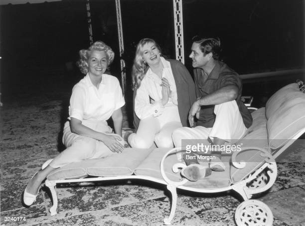 EXCLUSIVE Mrs Horace Elgin Dodge II Swedish actor Anita Ekberg and her husband actor Anthony Steel sit on a lawn chair at the Dodge estate in Palm...