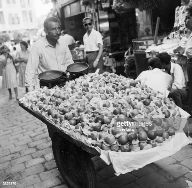 An apple cart makes its way through the narrow streets of Beirut