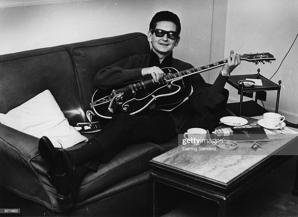 Rock 'n' roll legend, singer-songwriter <a gi-track='captionPersonalityLinkClicked' href=/galleries/search?phrase=Roy+Orbison&family=editorial&specificpeople=913944 ng-click='$event.stopPropagation()'>Roy Orbison</a> (1936 - 1988) otherwise known as 'The Big O' - relaxes with his guitar.