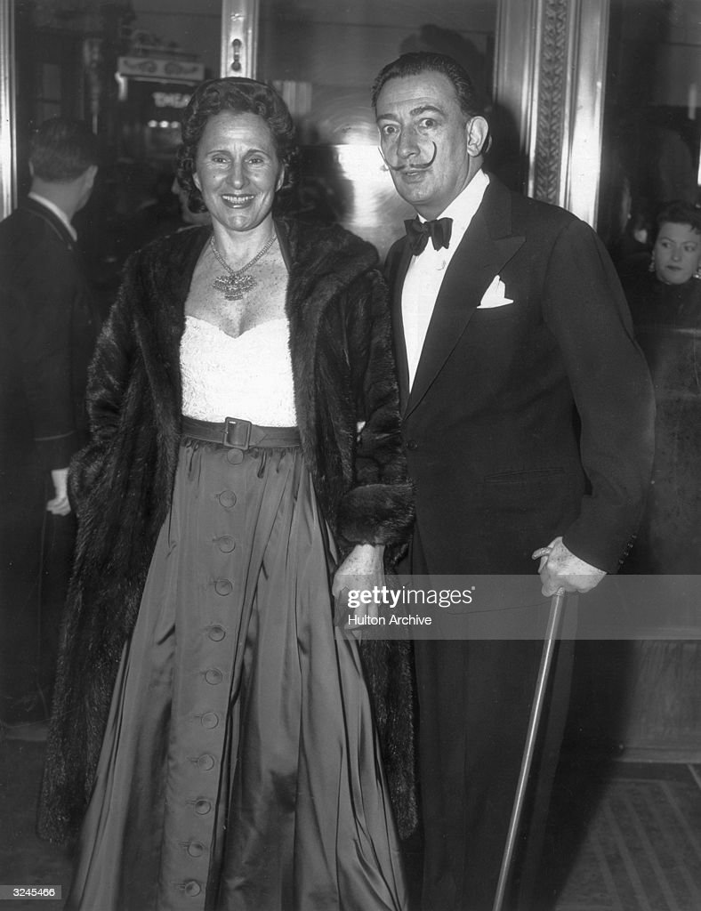 Spanish Surrealist artist Salvador Dali with his wife Gala pose together in formal evening clothes