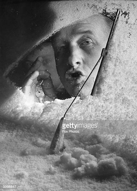 A motorist looking through his snow covered windscreen