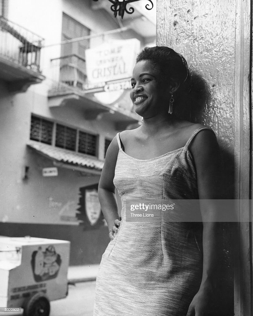 A woman standing in a doorway, Panama.