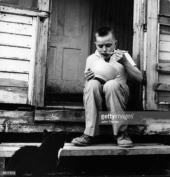 A young boy eating after a hard day's work