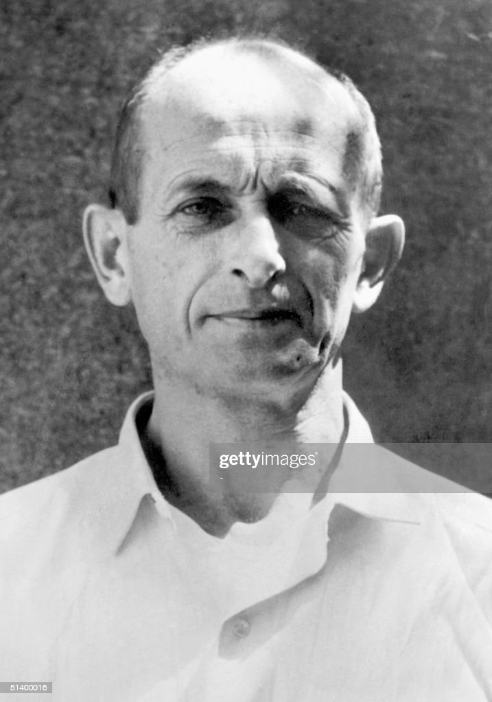 <a gi-track='captionPersonalityLinkClicked' href=/galleries/search?phrase=Adolf+Eichmann&family=editorial&specificpeople=930616 ng-click='$event.stopPropagation()'>Adolf Eichmann</a>, former Nazi SS leader. Captured by US forces in 1945, he escaped from prison some months later, having kept his identity hidden, and in 1950 reached Argentina. He was traced by Israeli agents, taken to Israel in 1960. Accused on 15 indictments of mass killings of Jews during World War II, he was condemned and executed in 1962.